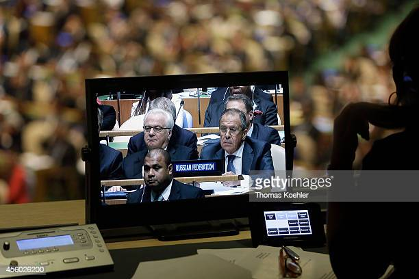 Foreign Minister of Russia Sergej Lavrov pictured in the display in the cabin of an interpreter watches as US President Barack Obama speaks at the...