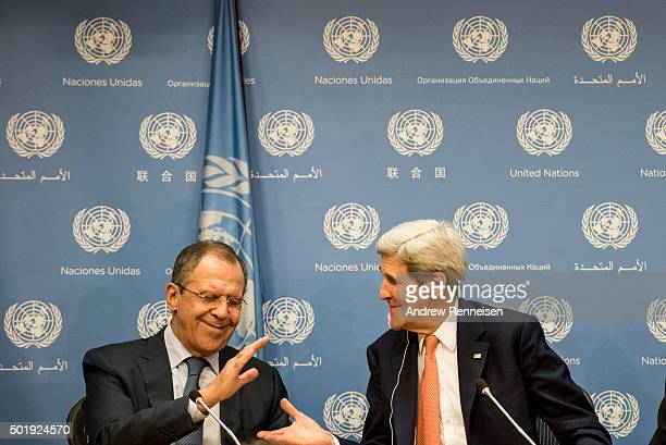 Foreign Minister of Russia Sergey Lavrov and US Secretary of State John Kerry shake hands following a news conference after a United Nations Security...
