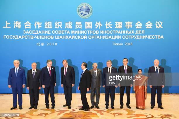 Foreign ministers and officials of the Shanghai Cooperation Organisation prepare to pose for a group photo before a meeting at the Diaoyutai State...