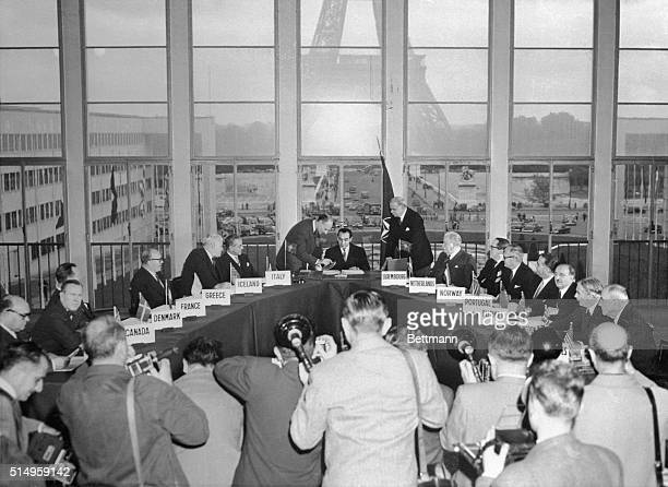 Foreign ministers from NATO counties look on as Pierre MendesFrance French foreign minister signs the treaties making West Germany a part of NATO...