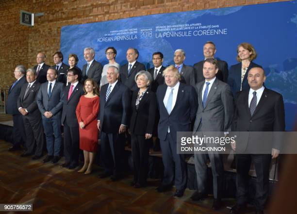 Foreign Ministers from twenty countries from North and South America Asia and Europe pose for a family photo at the Vancouver Foreign Ministers...
