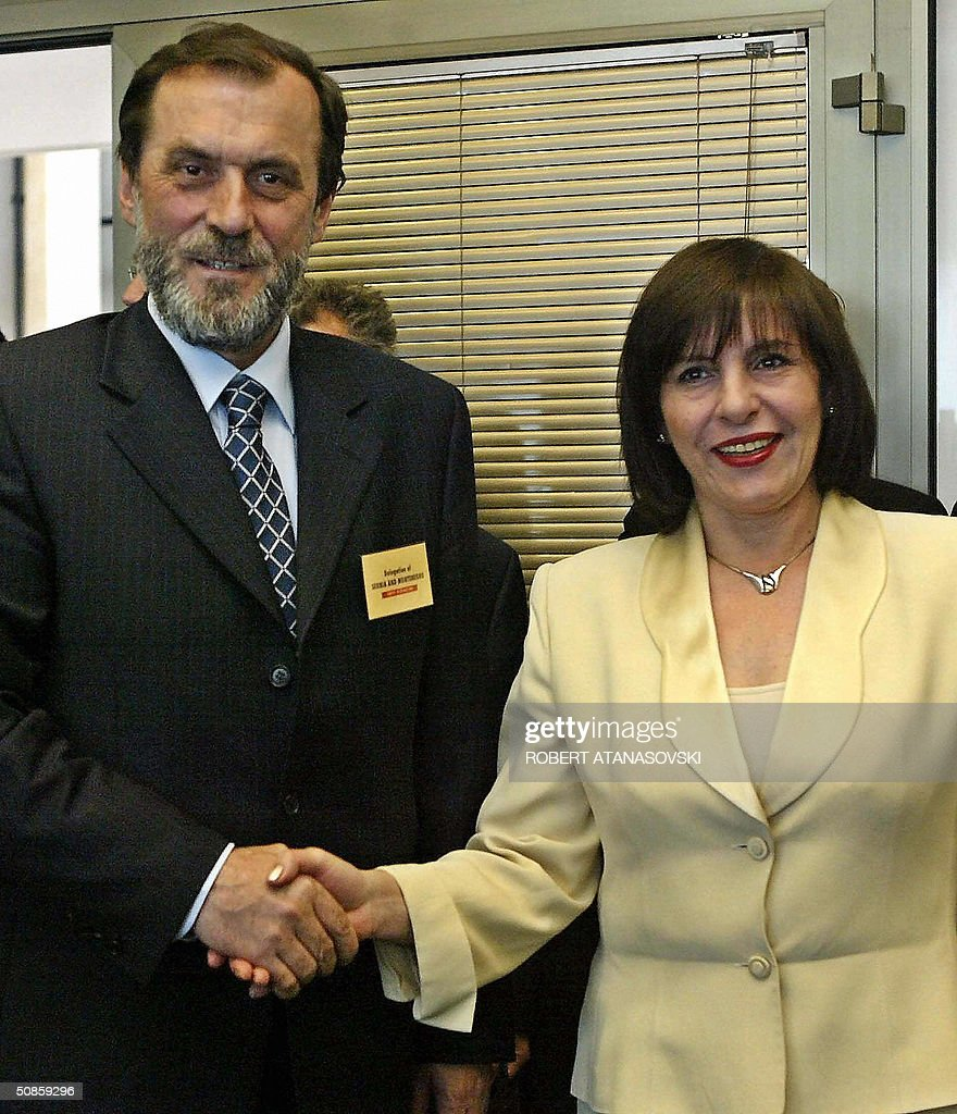 Foreign ministers Ilinka Mitreva from Macedonia (R) and Vuk Draskovic from Serbia-Montenegro meet at the second conference of the Adriatic Charter, held in the Macedonian capital Skopje 20 May 2004. The Adriatic Charters is a US sponsored partnership initiative between Balkan NATO hopefuls Macedonia, Croatia and Albania, while Draskovic had an observer role .