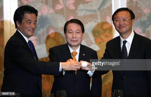 Foreign Ministers Katsuya Okada of Japan, Yu Myung-hwan of South Korean and Yang Jiechi of China toast during a dinner on May 15, 2010 in Gyeongju,...