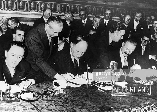 Foreign Ministers of France Belgium Holland Luxembourg Germany and Italy signing two treaties establishing the European Common Market and the atomic...