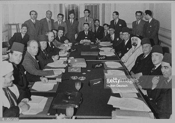 Foreign Ministers of Iraq Jordan Lebanon Syria Saudi Arabia and Egypt sit at the conference table during a meeting of the Arab League in Cairo Egypt...