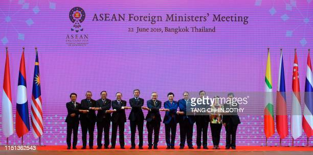 Foreign ministers of the Association of Southeast Asian Nations from left Laos Foreign Minister Saleumxay Kommasith Malaysia Foreign Minister...