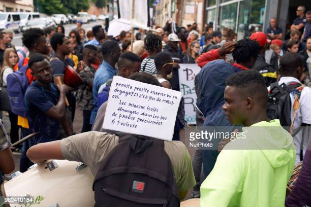 A foreign minor has a placard reading 'Should we stay or shall we go Unaccompagnied oreign minors on the streets of France specially in Toulouse'...