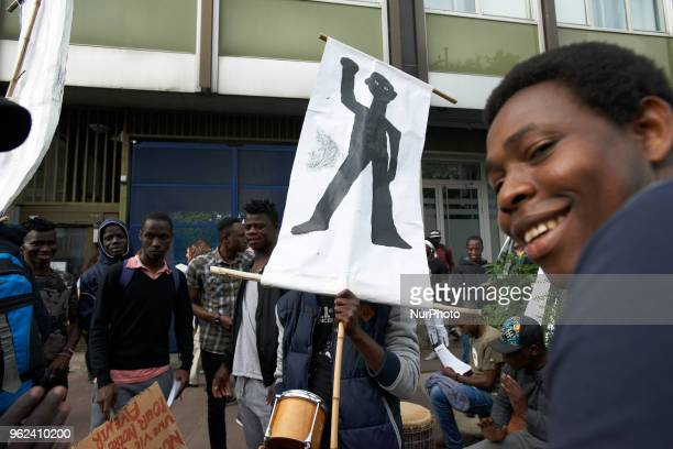 A foreign minor holds a drawing depicting himself Unaccompanied foreign minors gathered in front of the Small Claims Court in toulouse as the...