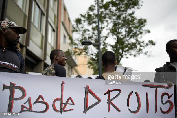Foreign minors hold a banner reading 'No Rights ' Unaccompanied foreign minors gathered in front of the Small Claims Court in toulouse as the...