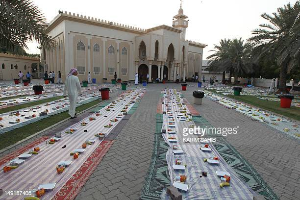 Foreign Muslim workers prepare to break their fast with a free Iftar dinner during the holy month of Ramadan in Dubai on July 24 2012 Muslims fasting...