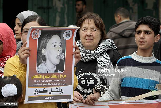A foreign peace activist joins Palestinian protesters for a demonstration marking the anniversary of the death of US peace activist Rachel Corrie who...