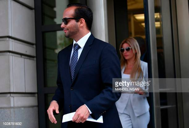 Foreign policy advisor to US President Donald Trump's election campaign George Papadopoulos and his wife Simona Mangiante Papadopoulos leave the US...