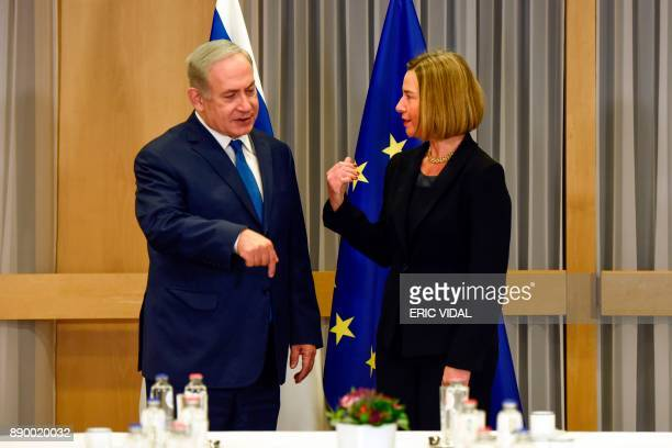 EU foreign policy chief Federica Mogherini gestures as she greets Israeli Prime Minister Benjamin Netanyahu upon his arrival for their meeting at the...