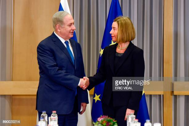 EU foreign policy chief Federica Mogherini greets Israeli Prime Minister Benjamin Netanyahu upon his arrival for their meeting at the European...