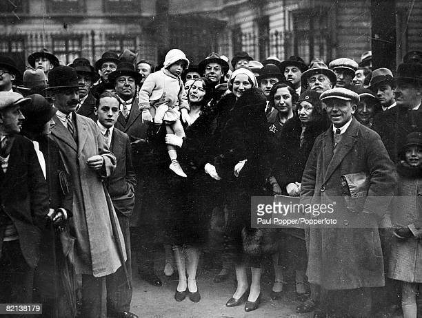circa 1930's Queen Astrid with Princess Josephine Charlotte standing among the crowd to watch a marchpast