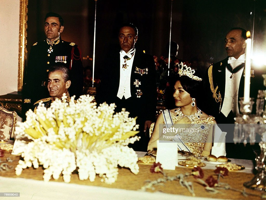 Foreign Royalty. Iran. pic: 1961. The Shah of Iran (Persia) and Queen Farah at a Gurlestan Palace banquet, Tehran. : News Photo