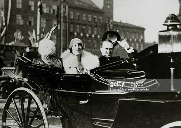 1929 Crown Prince Olav of Norway with Princess Martha of Sweden as they drive through the streets of Oslo with the Princess arriving for their royal...