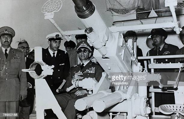 25th January 1957 The Shah of Iran inspects an antiaircraft guns aboard a naval ship the 'Keyvan' The Shah of Iran succeeded his father in 1941 but...