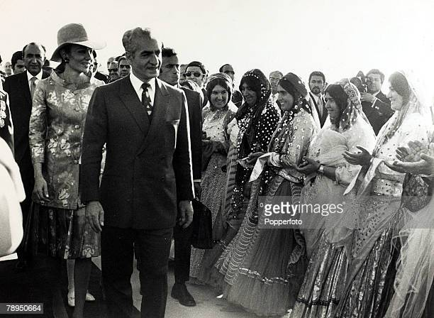 October 1971 at Persepolis The Shah of Iran with the Empress Farah Diba welcomed by gaily dressed Iranian women at a ceremony where the Shah laid a...