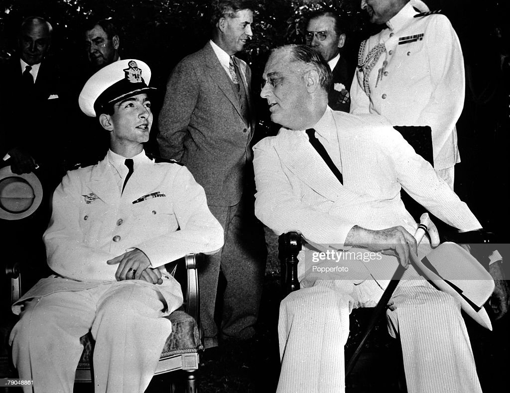 circa 1942, King Peter II of Yugoslavia, then living in exile after the German invasion of his country, seen in uniform talking to U,S, President Franklin D,Roosevelt