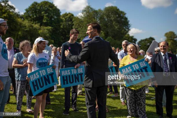 Foreign Secretary and Conservative leadership contender, Jeremy Hunt greets party members during a visit to Chawton House on July 3, 2019 in Alton,...