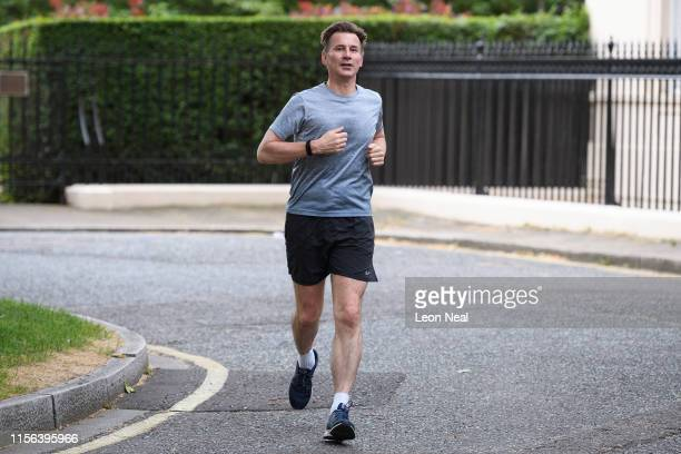 Foreign Secretary and Conservative Party leadership candidate Jeremy Hunt returns to his home following a morning run, on June 17, 2019 in London,...