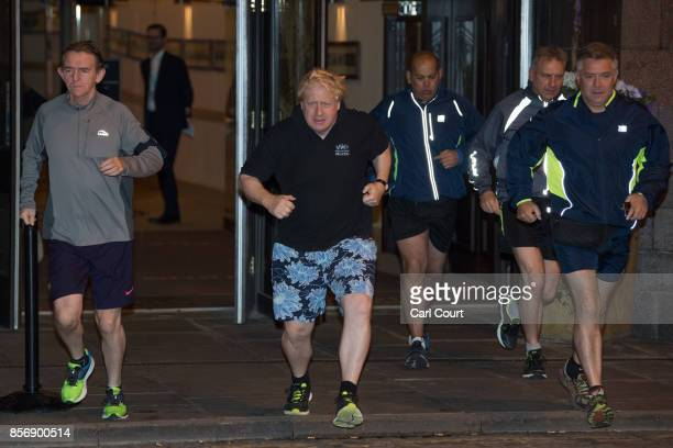 Foreign Secretary Boris Johnson and editor of The Sun newspaper Tony Gallagher go for a morning jog on day three of the annual Conservative Party...