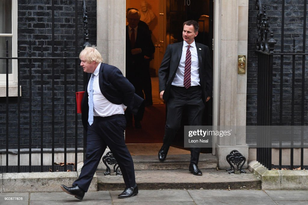 Foreign Secretary Boris Johnson and Health Secretary Jeremy Hunt leave Number 10 after government ministers attended the first Cabinet meeting of the year at 10 Downing Street on January 9, 2018 in London, England. Theresa May's reshuffled cabinet meets for the first time today. Justine Greening quit the government last night after being moved from Education, she is replaced by Damian Hinds. Health Secretary Jeremy Hunt's role has been extended to include social care, Esther McVey becomes Work and Pensions Secretary and Karen Bradley replaces James Brokenshire as Northern Ireland Secretary.