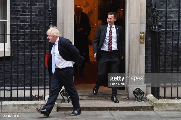 Foreign Secretary Boris Johnson and Health Secretary Jeremy Hunt leave Number 10 after government ministers attended the first Cabinet meeting of the...