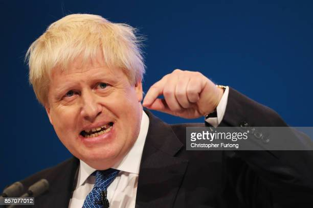 Foreign Secretary Boris Johnson delivers his keynote speech on day three of the annual Conservative Party conference on October 3 2017 in Manchester...