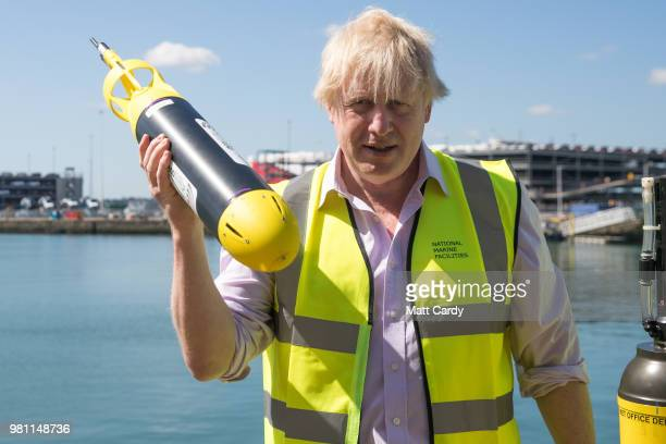 Foreign Secretary Boris Johnson stands besides a Met Office weather buoy that has been named Bouyris Johnson on a visit to National Oceanography...