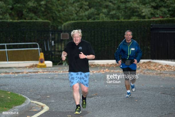 Foreign Secretary Boris Johnson is accompanied by a close protection police officer on his morning run on October 9 2017 in London England Prime...