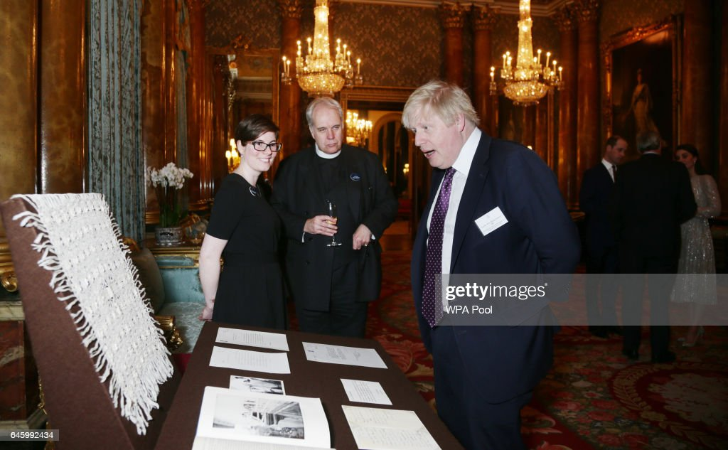 Foreign Secretary Boris Johnson looks at a shawl given to Queen Elizabeth II by Mahatma Gandhi during a reception to mark the launch of the UK-India Year of Culture 2017 on February 27, 2017 in London, England.