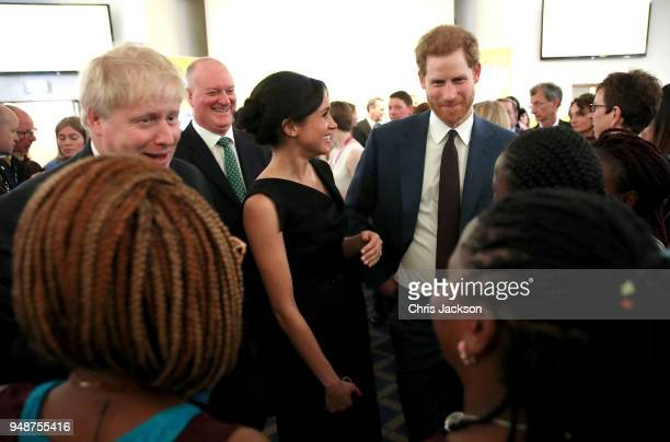 Foreign Secretary Boris Johnson Meghan Markle and Prince Harry speak with guests as they attend the Women's Empowerment reception hosted by the...