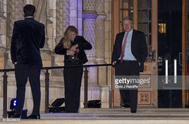 Foreign Secretary Boris Johnson passes Carrie Symonds as he leaves the Conservative party Black and White Ball at Natural History Museum on February...