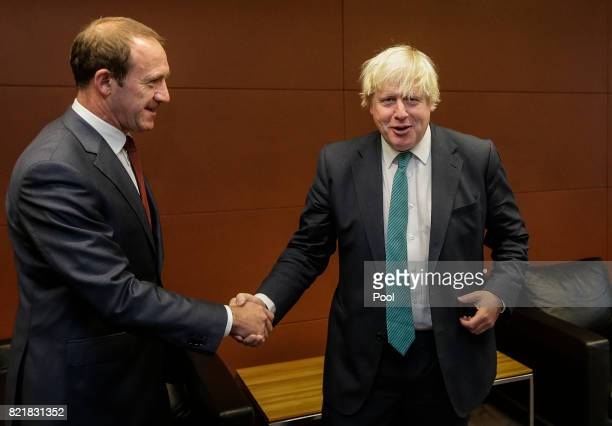 UK foreign secretary Boris Johnson shakes hands with Labour leader Andrew Little at Parliament on July 25 2017 in Wellington New Zealand The British...