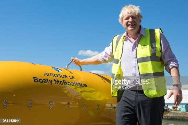 Foreign Secretary Boris Johnson stands next to Boaty McBoatface a autonomous underwater vehicle used for scientific research on a visit to National...