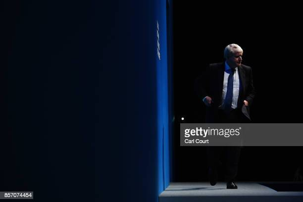 Foreign Secretary Boris Johnson walks on stage to deliver his keynote speech on day three of the annual Conservative Party conference on October 3...