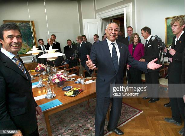 Foreign Secretary Colin Powell spreads out his arms prior to the political talks with Denmark's Prime Minister Anders Fogh Rasmussen 29 April 2004 in...