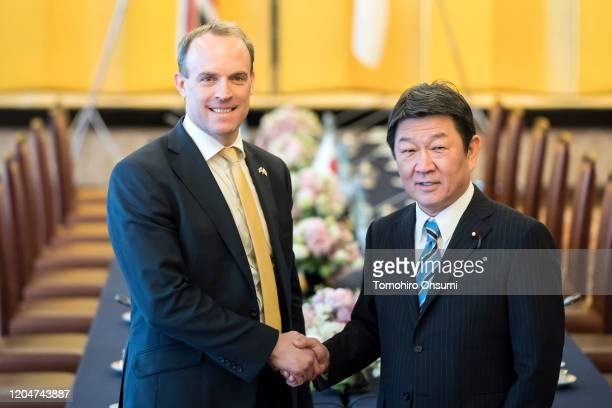 Foreign Secretary Dominic Raab and Japan's Foreign Minister Toshimitsu Motegi shake hands as they arrive for the eighth Japan-UK Foreign Ministers'...