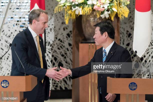 Foreign Secretary Dominic Raab and Japan's Foreign Minister Toshimitsu Motegi shake hands during a joint news conference following the eighth...