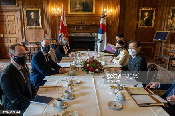 Foreign Secretary Dominic Raab and South Korean Foreign Minister Chung Eui-yong pose during talks at Chevening House on May 6, 2021 in Chevening,...