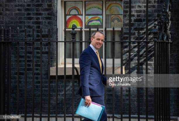Foreign Secretary Dominic Raab arrives at 10 Downing Street on May 11 2020 in London United Kingdom The prime minister announced the general contours...