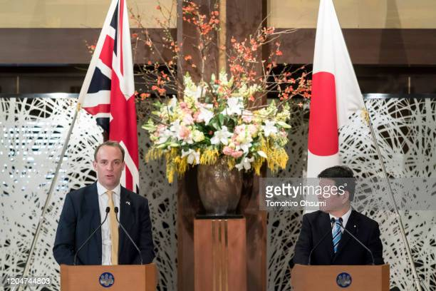 Foreign Secretary Dominic Raab speaks as Japan's Foreign Minister Toshimitsu Motegi looks on during a news conference following the eighth Japan-UK...