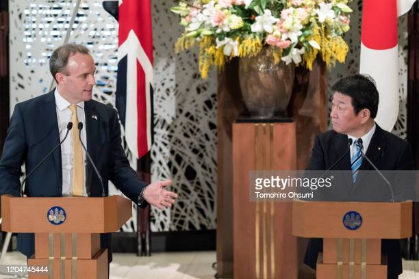 Foreign Secretary Dominic Raab speaks as Japan's Foreign Minister Toshimitsu Motegi looks on during a joint news conference following the eighth...