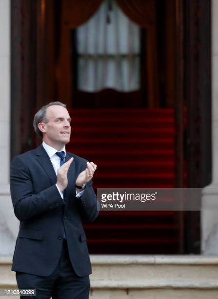 Foreign Secretary Dominic Raab takes part in Clap For Carers outside the Foreign Office on April 23 2020 in London United Kingdom Following the...