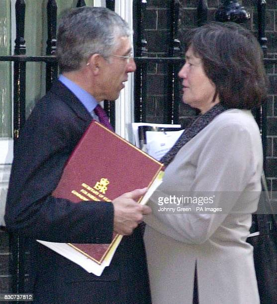 Foreign Secretary Jack Straw chats with International Development Secretary Clare Short as he leaves Downing Street Ms Short was not present at the...