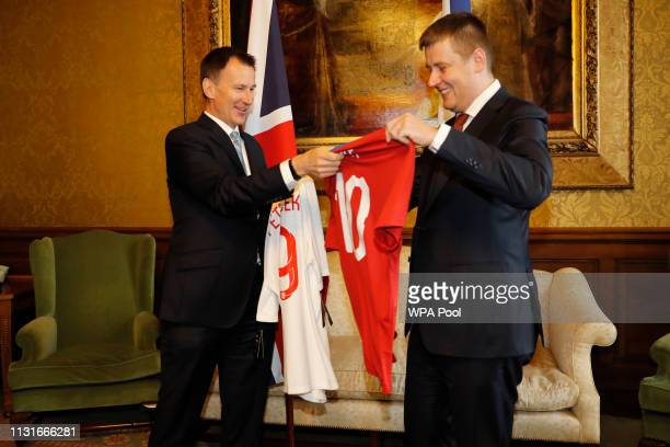 Foreign Secretary Jeremy Hunt exchanges football shirts with his Czech counterpart Tomas Petricek on arrival at the Foreign office on March 20 2019...
