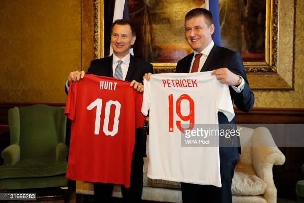Foreign Secretary Jeremy Hunt poses with his Czech counterpart Tomas Petricek as they hold up football shirts on arrival at the Foreign office on...