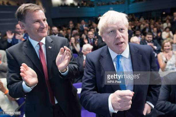 Foreign Secretary Jeremy Hunt reacts as fellow leadership contender Boris Johnson is elected as the new leader of the Conservative Party and British...